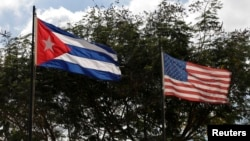 Flags of Cuba and the U.S. flutter in Havana, Cuba, Dec. 19, 2014.