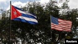 FILE - Flags of Cuba and the U.S. flutter in Havana, Cuba, Dec. 19, 2014.