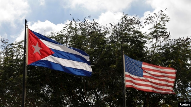 FILE - Flags of Cuba and the U.S. flutter in Havana, Cuba, Dec. 19, 2014.