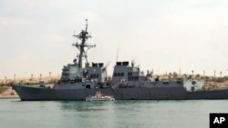 FILE - The U.S. destroyer USS Mason sails in the Suez canal in Ismailia, Egypt, March 12, 2011. Two missiles fired from rebel-held territory in Yemen landed near the destroyer in the Red Sea.