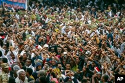 FILE - Protesters chant slogans against the government during a march in Bishoftu, in the Oromia region of Ethiopia, Oct. 2, 2016.