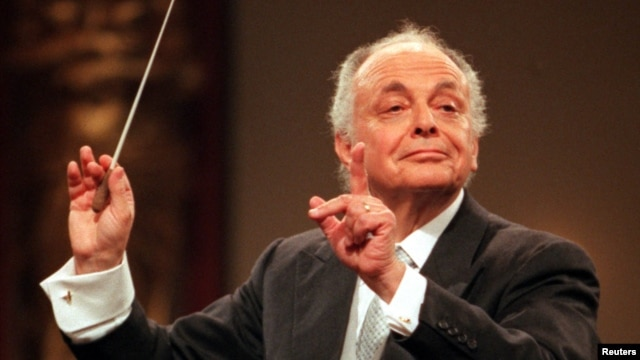 FILE - Maestro Lorin Maazel conducts the Vienna Philharmonic Orchestra during the main rehearsal for the annual New Years Concert, Dec. 30, 1998.