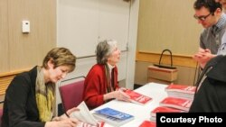 Betty Azar (right) and co-author Stacy Hagen sign books at the 2014 TESOL conference.