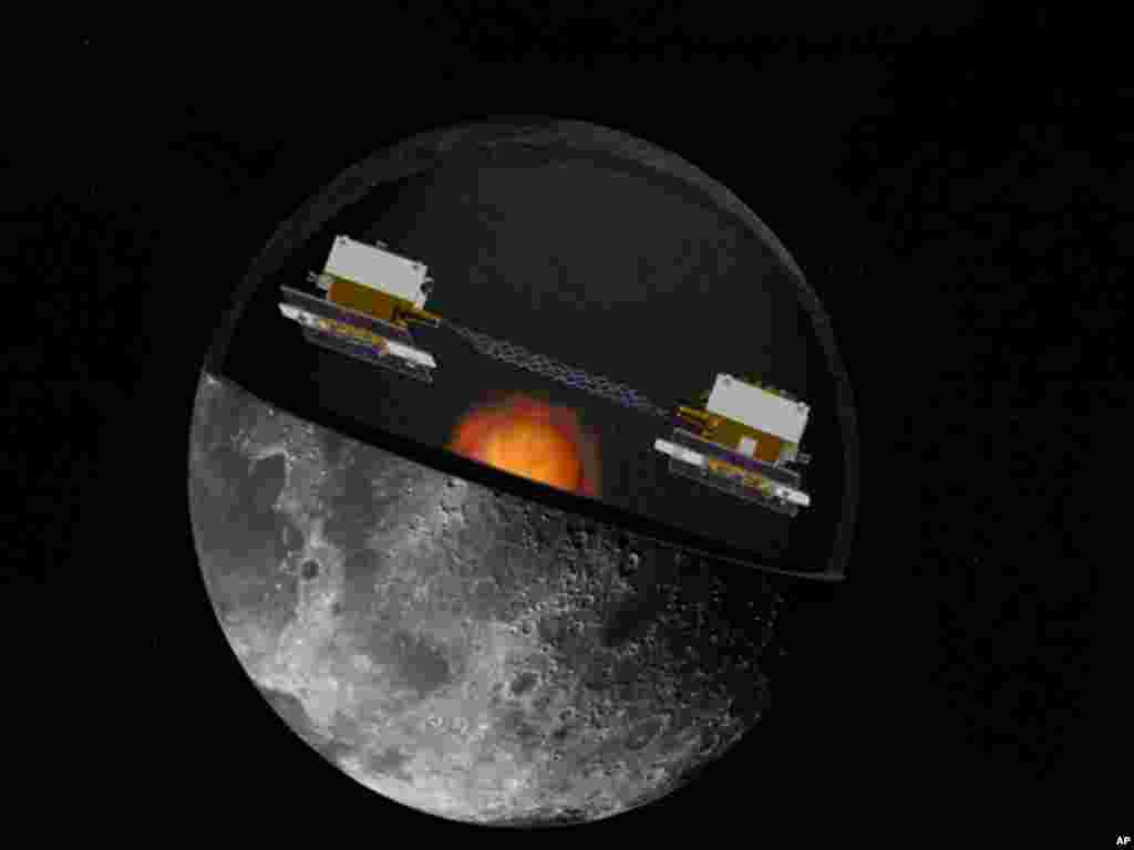 A NASA handout image shows an artist's concept of the GRAIL mission's twin spacecraft in orbit around the moon. (Reuters/NASA)