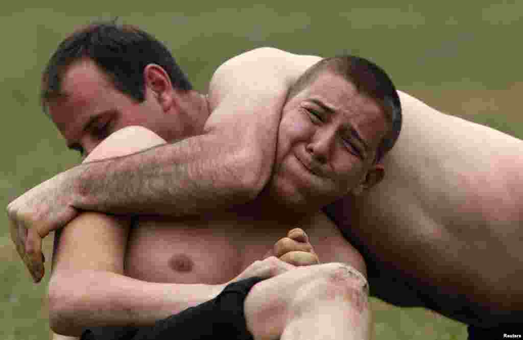 Men take part in a traditional wrestling competition in the village of Draginovo in the Rhodope mountains, southeast from the Bulgarian capital Sofia.