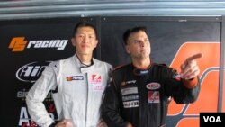 Race car drivers Sunny Wong and Pete Olson promote the charity the Child Fund in Zhuhai, China, Sept. 15, 2013. (Marianne Brown for VOA)