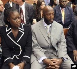 The parents of Trayvon Martin, Sybrina Fulton, left, and Tracy Martin, sit in the courtroom, April 20, 2012, during a bond hearing for George Zimmerman in Sanford, Florida.