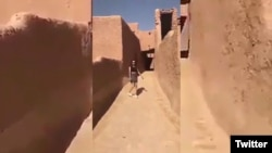 This screen grab of a video posted online purports to show a woman wearing a miniskirt and crop top at a historic fort in Ushaiger, Saudi Arabia.