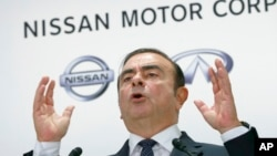 FILE - Nissan Motor Co. CEO Carlos Ghosn speaks during a press conference in Tokyo, Oct. 20, 2016.