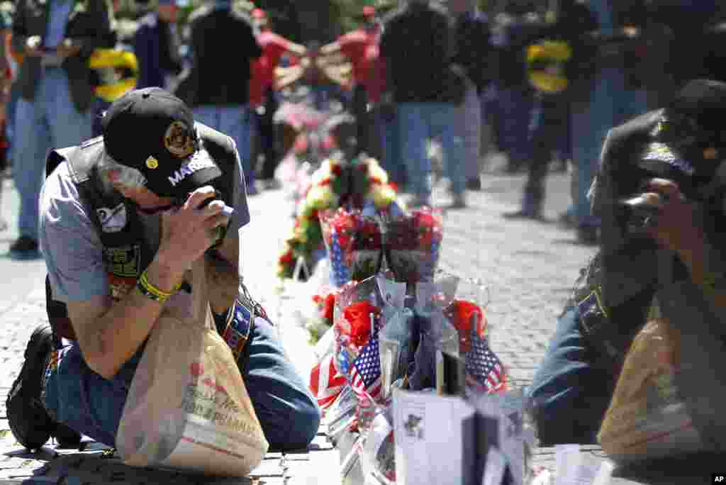 A veteran takes photographs at the Vietnam Veterans Memorial, ahead of Memorial Day in Washington, May 26, 2013.