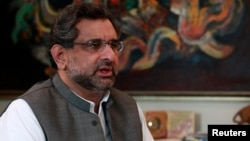 FILE - Pakistan's Petroleum and Natural Resources Shahid Khaqan Abbasi speaks during an interview at his office in Islamabad, Pakistan, Nov. 8, 2013. Abbasi is to succeed ousted Prime Minister Nawaz Sharif for a short term of 45 days.