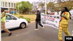 Rastafarians march to protest a ban on dreadlocks in primary schools, Lilongwe, Malawi. (Lameck Masina for VOA)