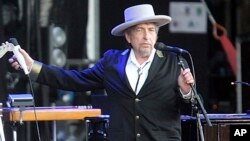 "FILE - This July 22, 2012, photo shows U.S. singer-songwriter Bob Dylan performing onstage at ""Les Vieilles Charrues"" Festival in Carhaix, western France."