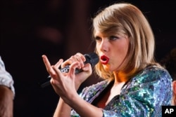 "FILE - Singer Taylor Swift performs during her ""1989"" world tour at MetLife Stadium ."