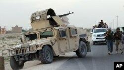 Các lực lượng an ninh Afghanistan trong một cuộc tuần tra ở thành phố Kunduz, Afghanistan, ngày 29/9/2015.
