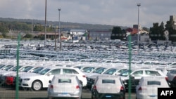 FILE - A picture taken on Sept. 25, 2015 shows cars parked at the logistics park of German auto giant Volkswagen in Villers-Cotterets.