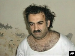FILE - A photo of alleged Sep 11, 2001 mastermind Khalid Sheikh Mohammed soon after he was arrested.