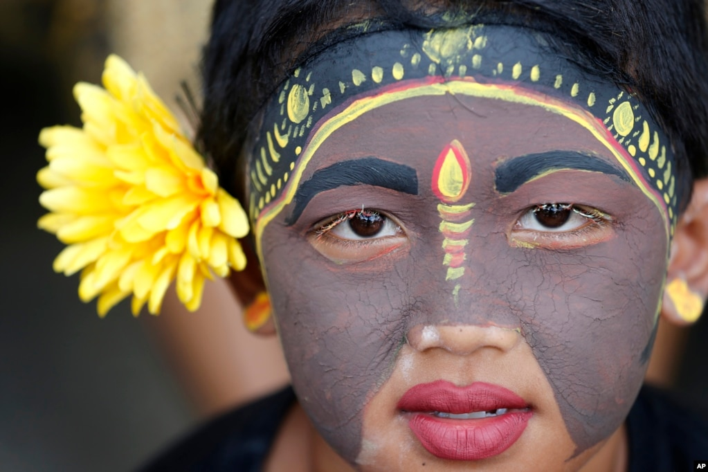 A Balinese youth takes part in the Hindu ritual of