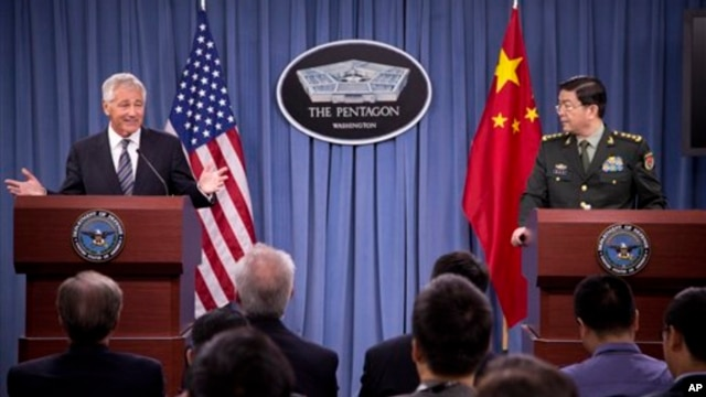 Defense Secretary Chuck Hagel gestures during a joint news conference with Chinese Minister of Defense Gen. Chang Wanquan at the Pentagon, Aug. 19, 2013.