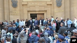 Leaders of the African National Congress Youth League speak outside the Johannesburg court where a judge ruled that leader Julius Malema has no right to sing a song some whites find offensive, September 12, 2011.