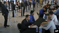 Job applicants receive interviews by Florida Marlins staff at Marlins Park in Miami, Florida, October 24, 2012.