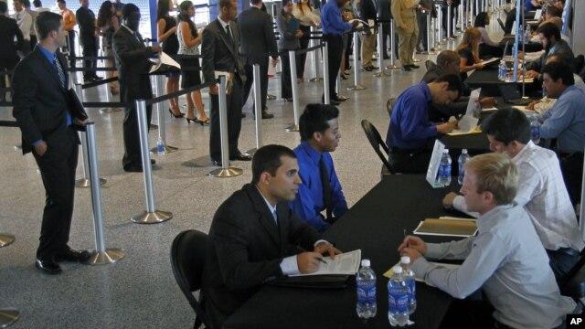 Job applicants receive interviews by Florida Marlins staff at Marlins Park in Miami, Florida, October 24, 2012.