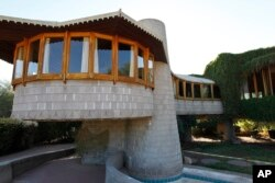FILE - This Oct. 19, 2012, photo shows a home that architect Frank Lloyd Wright designed for his son in Phoenix, Arizona.
