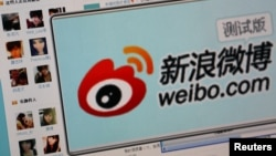 "Logo of Sina Corp's Chinese microblogging site, ""Weibo,"" on a screen, Beijing, September 2011."