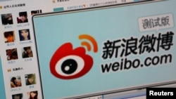 FILE - Logo of Sina Corp's Chinese microblogging site, Weibo, on a screen, Beijing, Sept. 2011.