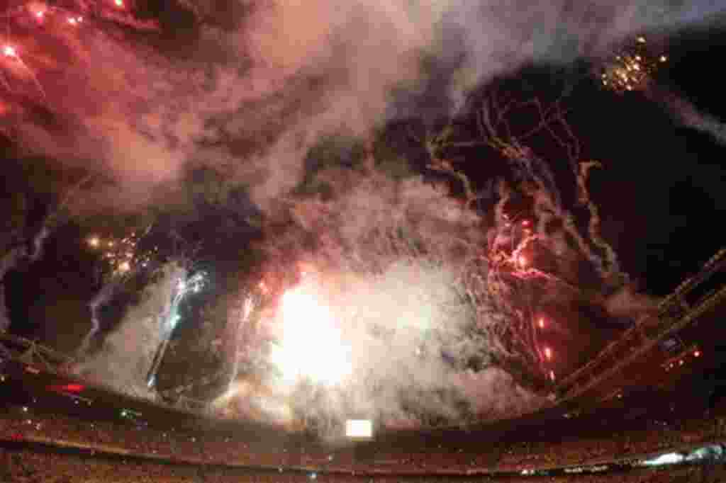 Fireworks are seen over the Metropolitan stadium during the opening ceremony of the U-20 World Cup soccer championship in Barranquilla, Colombia, Friday, July 29, 2011. (AP Photo/Fernando Llano)