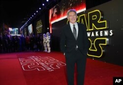 FILE - Harrison Ford poses for photographers upon arrival at the European premiere of the film 'Star Wars: The Force Awakens ' in London, Dec. 16, 2015.