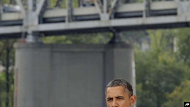 President Barack Obama delivers a speech promoting his jobs bill near the Brent Spence Bridge in Cincinnati, Ohio, Sept. 22, 2011
