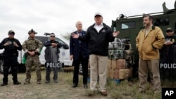 FILE - President Donald Trump speaks as tours the U.S. border with Mexico at the Rio Grande on the southern border, Jan. 10, 2019, in McAllen, Texas, as Sen. John Cornyn, R-Texas, left, and Sen. Ted Cruz, R-Texas, listen.