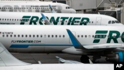 FILE - In this May 15, 2017, photo, Frontier Airlines jetliners sit at Denver International Airport in Denver.