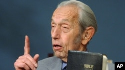 In this Dec. 12, 2002 file photo, Harold Camping speaks while holding the Bible, in San Leandro, Calif.
