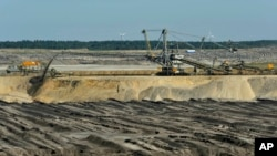 The Welzow-Sued open-pit coal mine, 70 miles south of Berlin, is one of several in eastern Germany's Lusatia region. It is expected to expand in the coming years and consume the village of Proschim, just over a mile away.