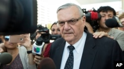 FILE - Former Sheriff Joe Arpaio leaves the federal courthouse, July 6, 2017, in Phoenix, Arizona.