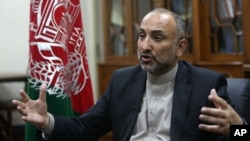 FILE - Afghan National Security Adviser Hanif Atmar speaks during an interview in Kabul, Afghanistan, Oct. 24, 2015. Atmar claims Islamic State fighters detained in Afghanistan had documents showing Pakistani citizenship.