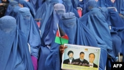 Burqa-clad Afghan women attend an election rally of Afghan presidential candidate Gul Agha Shirzai in Jalalabad, Nangarhar province, March 8, 2014.