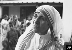 FILE - Mother Teresa, seen March 30, 1966, the superior-general of the Roman Catholic Missionaries of Charity, runs the Home for the Dying Destitutes in Calcutta, India.