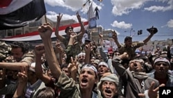 Anti-government protesters shout slogans during a demonstration demanding the resignation of Yemeni President Ali Abdullah Saleh, in Sana'a, Yemen, April 25, 2011