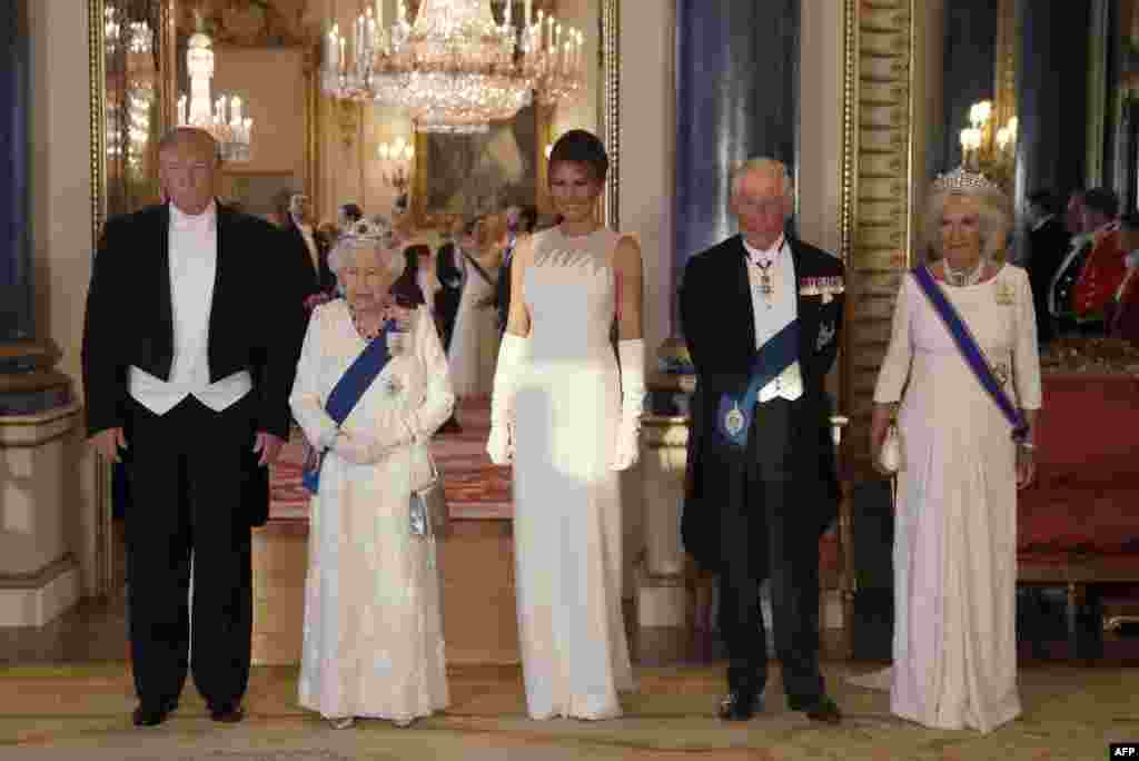 Britain's Queen Elizabeth II (2L), U.S. President Donald Trump (L), First Lady Melania Trump (C), Britain's Prince Charles, Prince of Wales (2R) and Britain's Camilla, Duchess of Cornwall pose for a photograph ahead of a State Banquet in the ballroom at Buckingham Palace in central London, June 3, 2019,