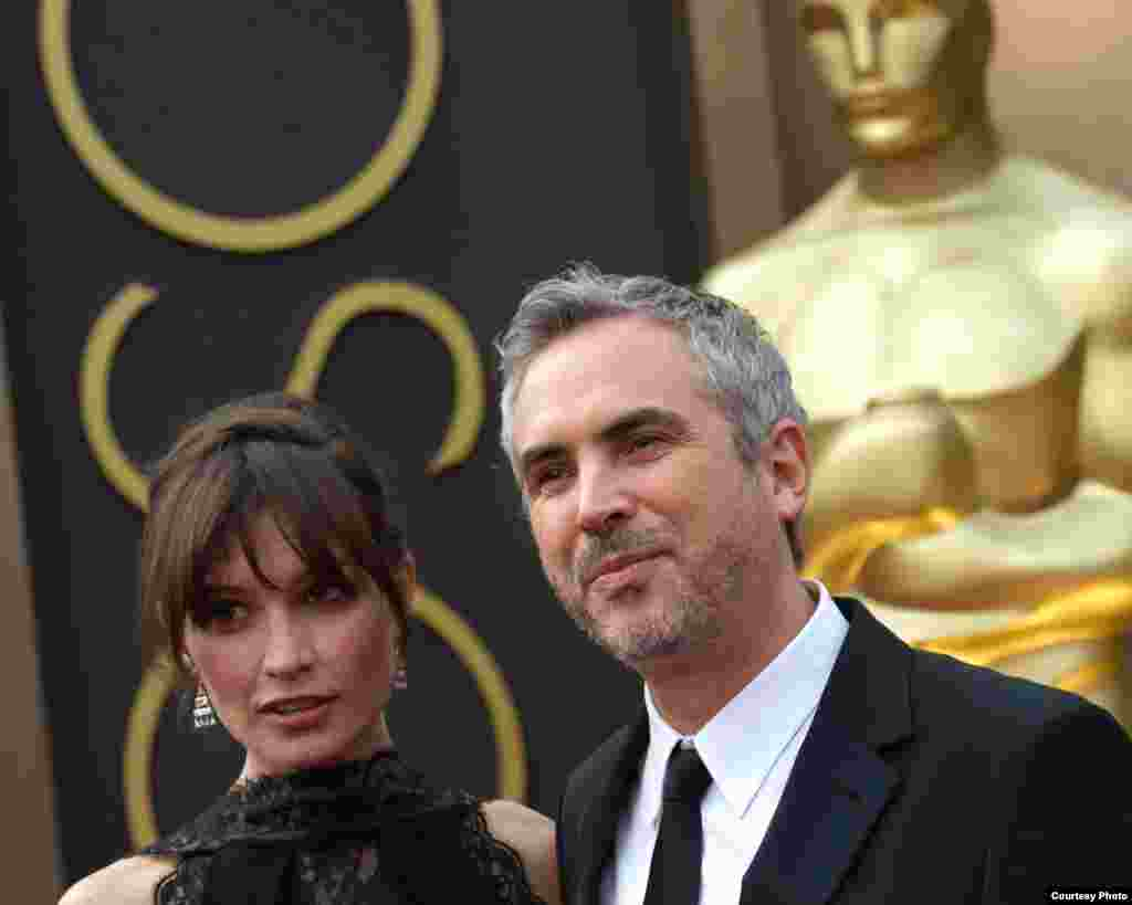Sheherezade Goldsmith and Oscar®-nominated director, Alfonso Cuaron arrive for The 86th Oscars® on March 2, 2014 in Hollywood, CA (Photo courtesy AMPAS)