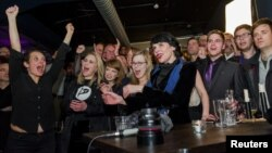 Pirate Party members react after early results of the parliamentary elections are announced in Iceland, Oct. 29, 2016. The advocates of direct democracy and digital freedom almost tripled their vote share from 5 percent in 2013 to 14.5.