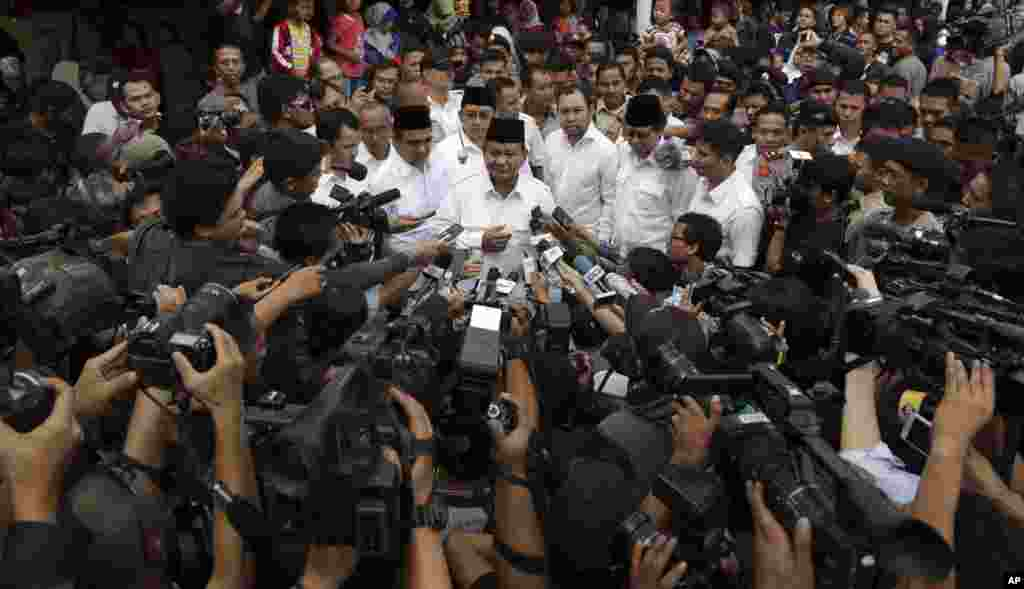 Indonesian presidential candidate Prabowo Subianto talks to journalists after casting his ballot at a polling station in Bogor, Indonesia, July 9, 2014.