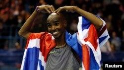 FILE - Britain's Mo Farah celebrates winning the Men's 5000m Action at the Birmingham Indoor Grand Prix, Barclaycard Arena, Feb. 18, 2017.