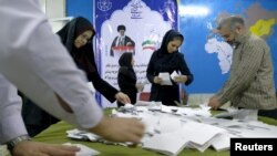 Election officials count ballot papers after the close of polling stations during elections for the parliament and a leadership body called the Assembly of Experts, which has the power to appoint and dismiss the supreme leader, in Tehran, Feb. 26, 2016.