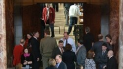 Lobbyists gather in the Capitol Rotunda in Lincoln, Nebraska, as state lawmakers debate on the floor of the Legislature in February 2009