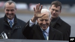 U.S. Vice President Joe Biden, center, waves to the media upon arrival at the Tegel airport in Berlin, Germany, Feb. 1, 2013. In the background left is U.S. ambassador to Germany Philip D. Murphy.