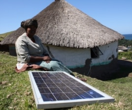 Nozethile Nkwaza powers her shebeen with a solar panel, and declares herself in favor of the radical anti-alcohol law (D. Taylor/VOA)